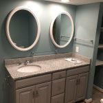 New bath vanity with oval mirrors