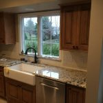 Cabinets with new granite and farmhouse sink