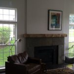 Fireplace transformed with oak log mantle