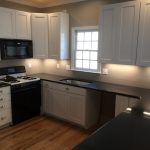Renovated kitchen with new cabinets,  quartz countertop and paint