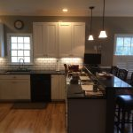 Renovated kitchen with new cabinets,  quartz countertop, backsplash tile and paint
