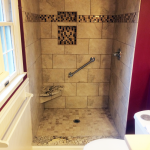 Tiled shower with granite seat and sill